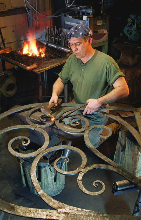 A man working at our decorative wrought iron studio in Califon, NJ